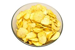 Plate with corrugated chips. On white background royalty free stock photo