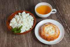 Plate with cottage cheese and a bun Stock Photos