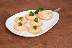 plate crackers with salmon pate and parsley Royalty Free Stock Image