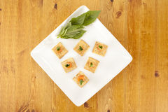 A plate of crackers with smoked salmon Royalty Free Stock Images