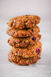 A plate of cranberry and oatmeal cookies served with a glass homemade panna cotta royalty free stock photography
