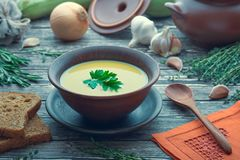 Plate with cream soup of lentils. Rural still life with a plate of lentil soup royalty free stock images