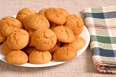 Plate of crisp Italian Amaretti cookies with a checkered napkin Stock Images