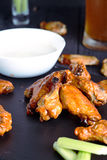 Plate of crispy delicious buffalo chicken wings Royalty Free Stock Photography