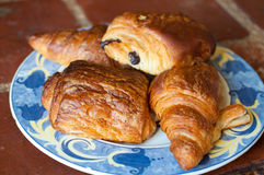Plate of croissants. A plate of plain and chocolate croissants Royalty Free Stock Photo