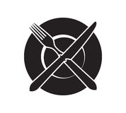 Plate with crossed fork and knife icon. Stock Photo