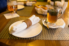 A plate and a cup of tea in a restaurant Royalty Free Stock Images