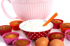 A plate with cupcakes and materials Royalty Free Stock Photography