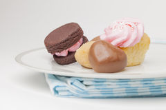Plate of cupcakes and other desserts Stock Photography