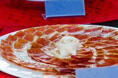 Plate with cut slices of jamon serrano, traditional Spanish ham. Meat stock photography
