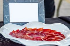 Plate with cut slices of jamon serrano, traditional Spanish ham. Meat stock image