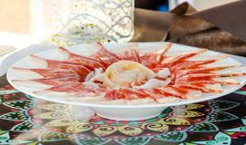 Plate with cut slices of jamon serrano, traditional Spanish ham. Meat royalty free stock photography
