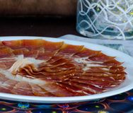 Plate with cut slices of jamon serrano, traditional Spanish ham. Meat stock images