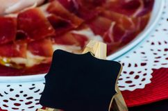 Plate with cut slices of jamon serrano, traditional Spanish ham. Meat royalty free stock photos