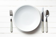 Plate with cutlery. On kitchen table Stock Photography