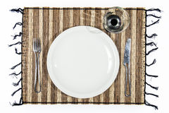 Plate, cutlery and cup on a single bamboo isolated on white back Stock Images