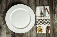 Plate with cutlery and napkin. Creative vintage tableware, top view Stock Photo