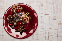Plate, cutlery on rustic wooden background. Christmas table Stock Image