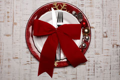 Plate, cutlery on rustic wooden background. Christmas table Stock Images