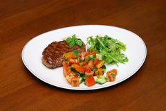 Plate with the cutlet and vegetables Stock Photography