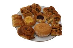 Plate of Danish pastry and doughnut Royalty Free Stock Images