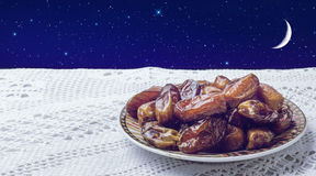 Plate of dates and night sky Stock Photos