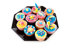Plate with decorated cupcakes Royalty Free Stock Photography