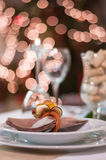 Plate with decoration on christmas table. White plate on christmas table with decoration Stock Photography