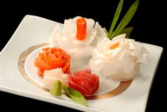 Plate of decrative sashimi in the forms of flowers Royalty Free Stock Images