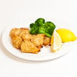 Deep Fried Shrimps with Broccoli Stock Photos