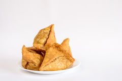 Plate with deep fried Samosas on white Stock Image