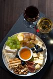 Plate with deli snacks and glasses of wine, vertical, top view Stock Images