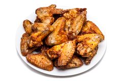 Plate of delicious barbecue chicken wings Royalty Free Stock Images