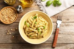 Plate of delicious basil pesto pasta served for dinner royalty free stock photos