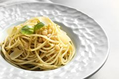 Plate of delicious basil pesto pasta on table stock image
