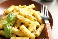 Plate of delicious basil pesto pasta on table royalty free stock photo