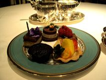 A plate of delicious cakes and dainties royalty free stock photo