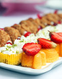Plate with delicious cakes Royalty Free Stock Images