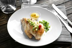 Plate with delicious chicken breast Stock Images