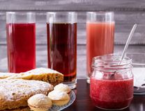 A plate of delicious cookies with berries, nuts, jam and apple juice on the table royalty free stock photos