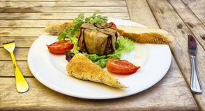 Plate with delicious food on wooden table Stock Photos