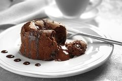 Plate of delicious fresh fondant with hot chocolate. On table. Lava cake recipe Stock Images