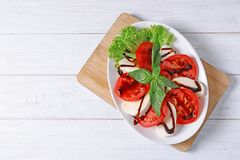 Plate with delicious fresh salad on table Royalty Free Stock Images