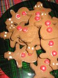 A plate of delicious gingerbread me cookies for Christmas stock photography