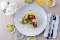 Grilled salmon wrapped in bacon and polenta salsa flat lay stock photos