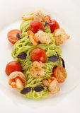 Plate of delicious italian pasta: spaghetti with shrimps and cherry Stock Images