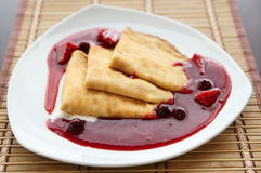 Plate of delicious pancakes with berry jam Royalty Free Stock Images