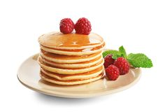 Plate with delicious pancakes. On white background Royalty Free Stock Photo