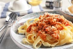 Plate with delicious pasta bolognese on table. Closeup Stock Photo