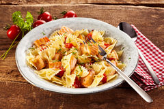 Plate of delicious pasta. With italian farfalle noodles on rustic plate Royalty Free Stock Photography